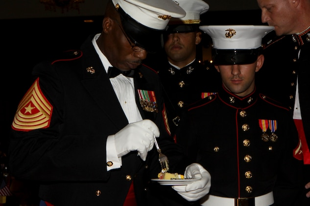 U.S. Marine Sgt. Maj. Anthony P. Goss, sergeant major of Combat Logistics Battalion 31, 31st Marine Expeditionary Unit, eats his piece of cake as the oldest Marine present during the Marine Corps' 236th birthday celebration at the Butler Officers Club, Plaza Housing, Okinawa, Japan on December 1, 2011. The Marine Corps Birthday Ball is an annual tradition celebrated throughout the entire Marine Corps. The 31st MEU is the only continually forward-deployed MEU, and remains the United States' force in readiness in the Asia-Pacific region.