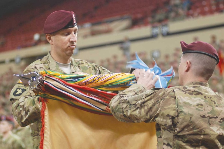 Army Lt. Col. John Hinson, 725th Brigade Support Battalion, commander, and Command Sgt. Maj. Brian Morrison case their unit colors at the deployment ceremony for the 4th Brigade Combat Team (Airborne), 25th Infantry Division, at Sullivan Arena in Anchorage Tuesday. (U.S. Army photo/Staff Sgt. Matthew Winstead)