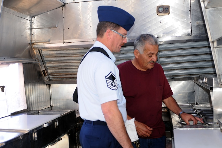 """Master Sgt. Rick Talvy completes an inspection of the mobile kitchen with """"La Herradura"""" owner Jaime Gomez Nov. 30. Gomez and his team will serve meals on base during the full-time work week, a first for the 162nd Fighter Wing in several years. (U.S. Air Force photo/Maj. Gabe Johnson)"""