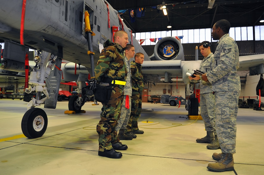 SPANGDAHLEM AIR BASE, Germany – Airmen assigned to the 52nd Aircraft Maintenance Squadron take part in a mission briefing before starting a munitions-loading evaluation here Nov. 29. The evaluation ensures load-crew members and team chiefs retain their qualification to load all munitions and are ready for mission taskings. Crew members complete an evaluation every month and are required to be evaluated annually while wearing chemical-warfare gear. (U.S. Air Force photo/Airman 1st Class Dillon Davis)