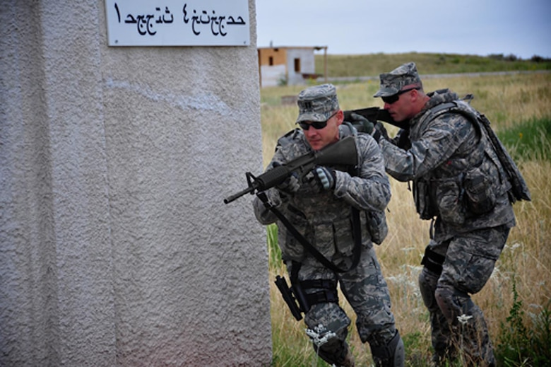 Captains Darrel DeLeon and Josh Curtis tackle Combat Airman Skills Training at Camp Guernsey, Wyo. before their deployments.  DeLeon served primarily as the International Security Assistance Force Rule of Law liaison officer while in theater.  (Courtesy photo)