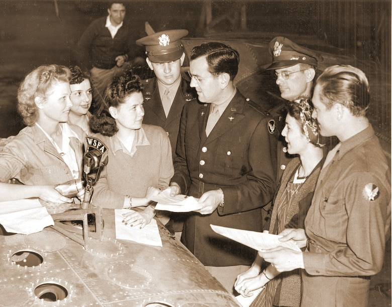 In this Air University History office file photo, Glenn Miller, center, prepares for one of the more than 500 radio broadcasts in which he and his band performed as part of morale-boosting efforts in tihe Army Air Force.