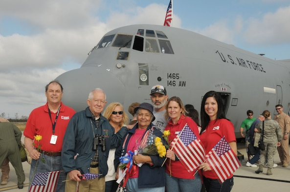 Members of the local Red Cross pose in front of a C 130 that brought home members of the 146th Airlift Wing that returned from an overseas deployment at Channel Islands Air National Guard Station on November 23, 2011. The Red Cross was on hand to welcome home airmen returning from a 90 day AEF rotation in Afghanistan.