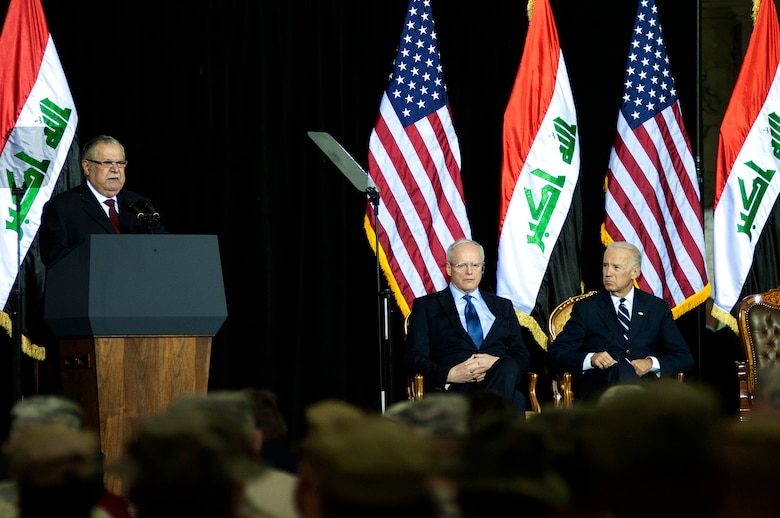President of Iraq, Jalal Talabani, gives a speech during the Commitment Day ceremony in the Al Faw Palace at Victory Base Complex, Iraq, on Dec. 1, 2011. The Government of Iraq hosted the ceremony to commemorate the sacrifices and accomplishments of U.S. and Iraqi service members. Ambassador to Iraq, James F. Jeffrey (left) and Vice President of the United States, Joe Biden (right), were present for the ceremony. (U.S. Air Force photo/Master Sgt. Cecilio Ricardo)