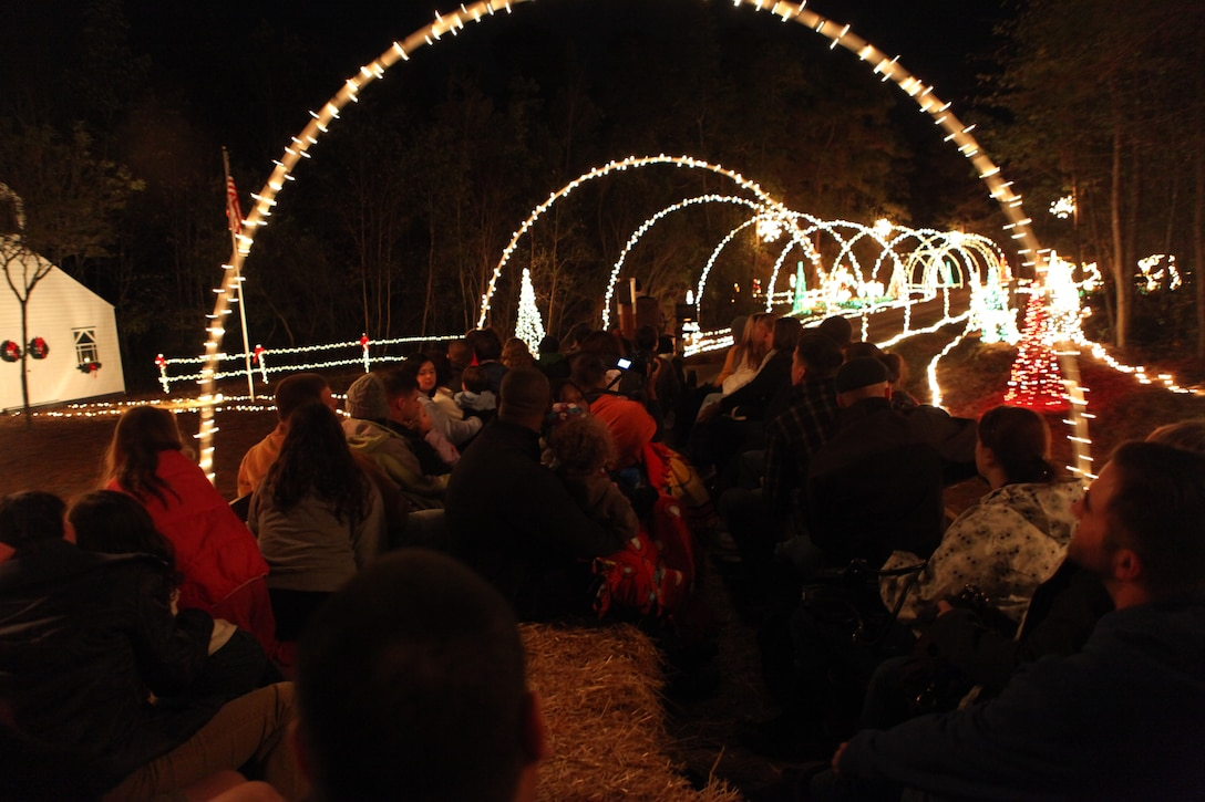 People go through a tunnel of lights during the Holiday Lights, Hayride and Dinner at Mike's Farm on Dec. 4. The event was created by the Midway Park and Tarawa Terrace Community Centers.(Official U.S. Marine Corps Photo by Pfc. Jackeline M. Perez Rivera)::r::::n::