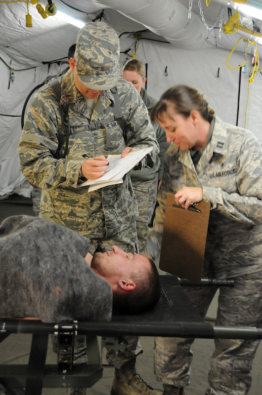 Members of the 144th Medical Group take part in specialized training during a Homeland Response Force exercise in Phoenix, Ariz. on November 5, 2011.  Capt. Veronica Repp, 144th Medical Group, helps treat a patient in triage. (USAF photo by Master Sgt. David J. Loeffler)