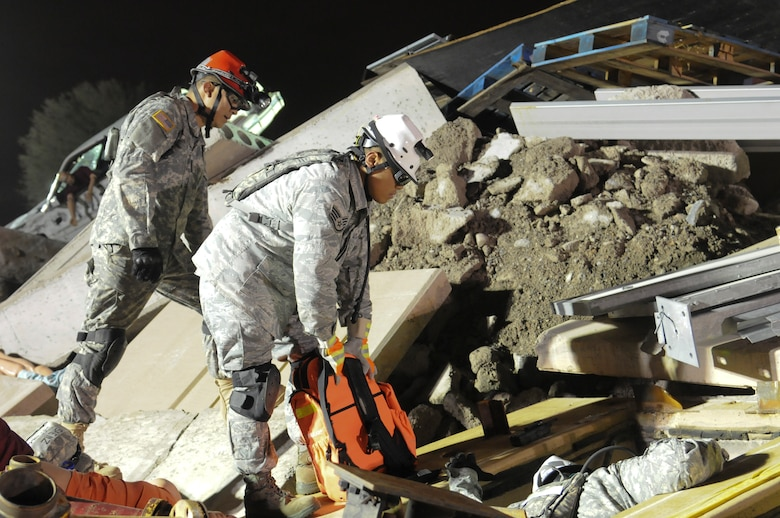Two search and rescue members prepare to take a wounded victim from a rubble pile as part of a 36-hour specialized training Homeland Response Force exercise in Phoenix, Ariz. on November 5, 2011. (USAF photo by Master Sgt. David J. Loeffler)