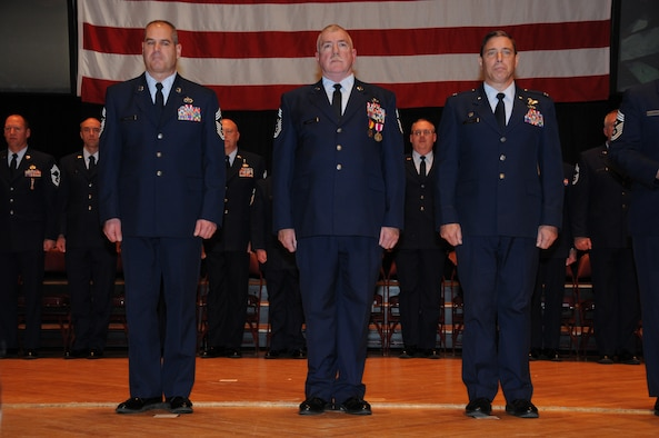 148th Fighter Wing Command Chief Master Sgt. Mark Rukavina, Command Chief Master Sgt.  Michael Layman, and 148th Fighter Wing Commander Col. Frank Stokes stand during the transfer of authority ceremony held Dec. 4, 2011 in Duluth, Minn.  The command chief is the representative of all the enlisted personnel at the 148th, and is the liasion between the commander and the enlisted Airmen. (National Guard photo by Tech. Sgt. Brett Ewald)