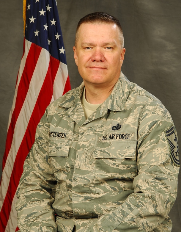 Senior Master Sgt. Dwight Christensen, 151st Air Refueling Wing first sergeant, poses for an official photo before his deployment to Iraq. U.S. Air Force photo by Tech. Sgt. Kelly Collett (RELEASED)