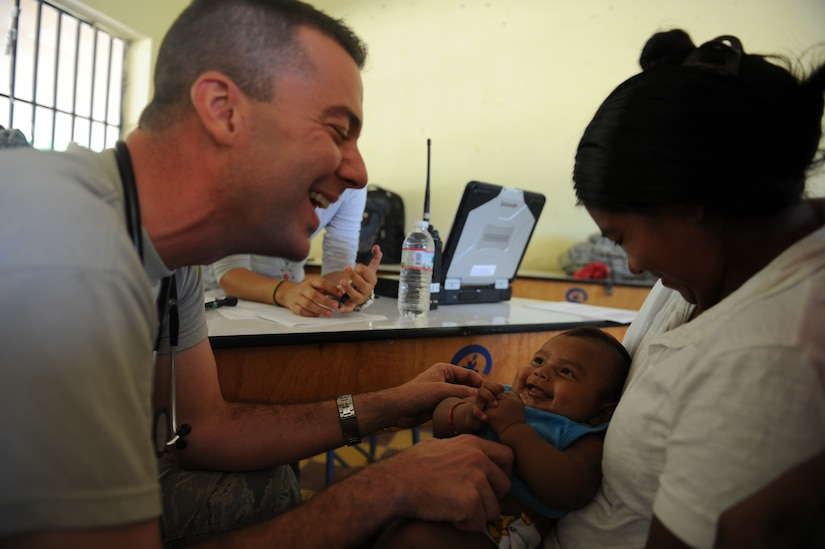 Capt. Eric Baroni, a Joint Task Force-Bravo Medical Element physician's assistant, performs a check up on a Honduran baby during a Medical Readiness Training Exercise Nov. 29, 2011, at a school in Choluteca, Honduras.  (U.S. Air Force photo/Tech. Sgt. Matthew McGovern)