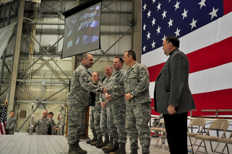 Chief Master Sgt. Christopher Chatham, 128th Air Refueling Wing maintenance squadron superintendent, shakes hands with Command Chief Master Sgt. Joe Parlato during a Hometown Heroes Salute Campaign award ceremony at the 128th Air Refueling Wing, Milwaukee, on Sunday, December 4, 2011.  Chatham received a wood-framed letter of appreciation signed by the director and the command chief master sergeant of the Air National Guard for his duty while deployed overseas.  The Hometown Heroes Salute Campaign is an Air National Guard event that recognizes Airmen who have deployed overseas for more than 30 days.  Air National Guard photo by Tech. Sgt. Tom Sobczyk.