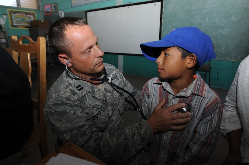 Capt. James Davis, a Joint Task Force-Bravo Medical Element physician's assistant, performs a check up on a Honduran boy during a Medical Readiness Training Exercise Nov. 29, 2011, at a school in Choluteca, Honduras.  More than 20 medical personnel from JTF-Bravo along with their Honduran partners, back rounding in various medical fields, military members, Boy Scouts, and the Honduran Ministry of Health, provided general medical care to over 2,800 flood victims. (U.S. Air Force photo/Tech. Sgt. Matthew McGovern)
