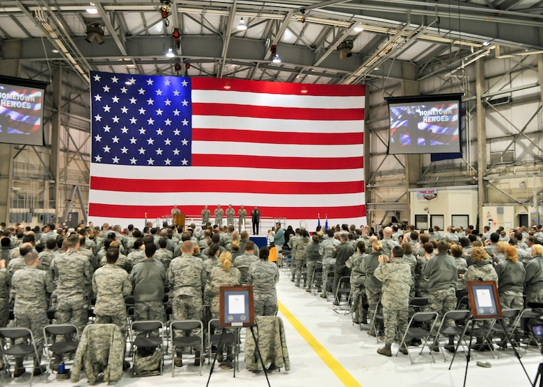 Senior military and civilian officials lead applause at the conclusion of a Hometown Heroes Salute Campaign award ceremony at the 128th Air Refueling Wing, Milwaukee, on Sunday, December 4, 2011.  Over 500 Airmen and family members attended the award ceremony wherein over 100 Airmen were formally recognized for their contributions while deployed overseas.  The Hometown Heroes Salute Campaign is an Air National Guard event that recognizes Airmen who have deployed overseas for more than 30 days.  Air National Guard photo by Tech. Sgt. Tom Sobczyk.
