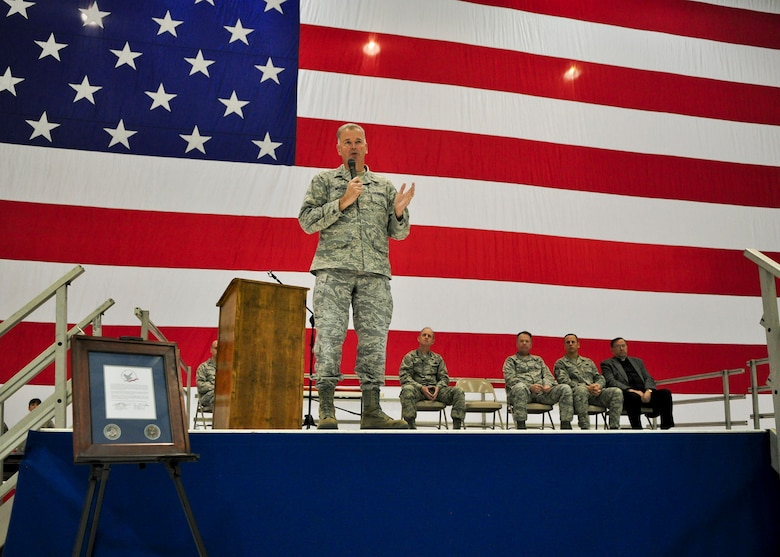 """Brig. Gen. John E. McCoy, Wisconsin's assistant adjutant general for Air, addresses a gathered crowd of Airmen and family members during a Hometown Heroes Salute Campaign award ceremony at the 128th Air Refueling Wing, Milwaukee, on Sunday, December 4, 2011.  Gen. McCoy applauded the recipient Airmen's ability to """"do the work America asks of us.""""  The Hometown Heroes Salute Campaign is an Air National Guard event that recognizes Airmen who have deployed overseas for more than 30 days.  Air National Guard photo by Tech. Sgt. Tom Sobczyk."""