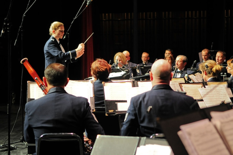 Capt. Haley Armstrong, commander and conductor of the United States Air Force Band of the Golden West, directs the band during a holiday concert performance at the Sacramento Convention Center Nov. 30, 2011. The Band of the Golden West plays as many as 350 performances, ceremonies and military events every year, and can be broken into six smaller groups including a rock band. (U.S. Air Force photo by Staff Sgt. Sarah Brown/RELEASED)