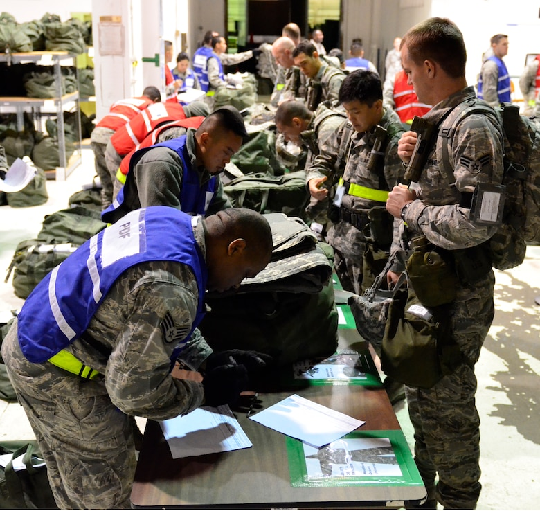 California Air National Guardsmen assigned to the 129th Rescue Wing process through a simulated personal deployment function line during the first phase of an Air Combat Command Operational Readiness Inspection at Moffett Federal Airfield, Calif., Dec. 3, 2011. The Phase I ORI tests the unit's wartime capabilities and readiness to deploy to a tactical area of responsibility. (Air National Guard photo by Airman 1st Class John. D. Pharr II)