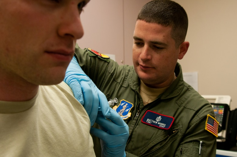 Master. Sgt. Matthew Morris, 139th Medical Group, administers an immunization to an Airman at the 139th Airlift Wing, St. Joseph, Mo., Dec. 3, 2011. Hundreds of Airmen have received the flu shot during the 2011-2012 flu season so far. (MIssouri Air National Guard photo by Senior Airman Kelsey Stuart)