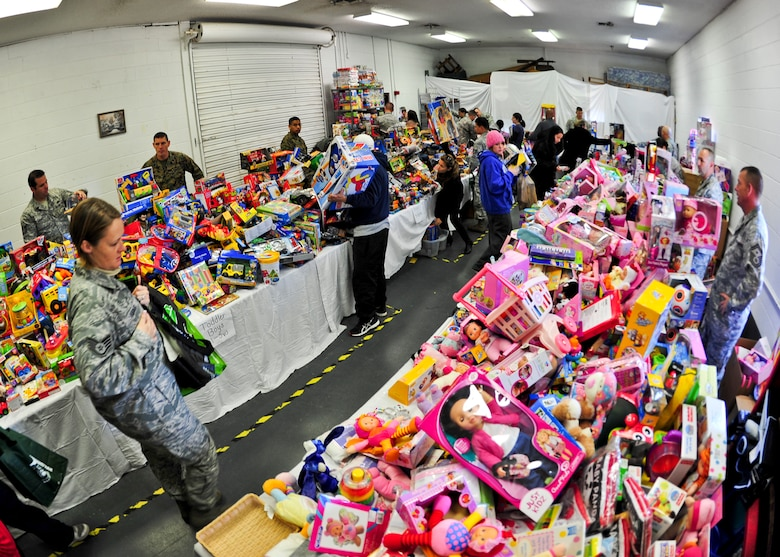 Volunteers became Santa's elves organizing more than 4,000 donated toys during the 8th annual toy distribution at the Airman's Attic Nov. 30. More than 200 families in the Eglin community were helped. (U.S. Air Force photo/Sachel Seabrook)