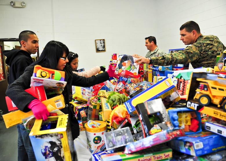 Service members were on hand to help families pick out gifts at the 8th annual toy distribution Nov. 30 at the Airman's Attic. More than 4,000 toys were donated for the event, helping more than 200 families in the Eglin community.  (U.S. Air Force photo/Sachel Seabrook)