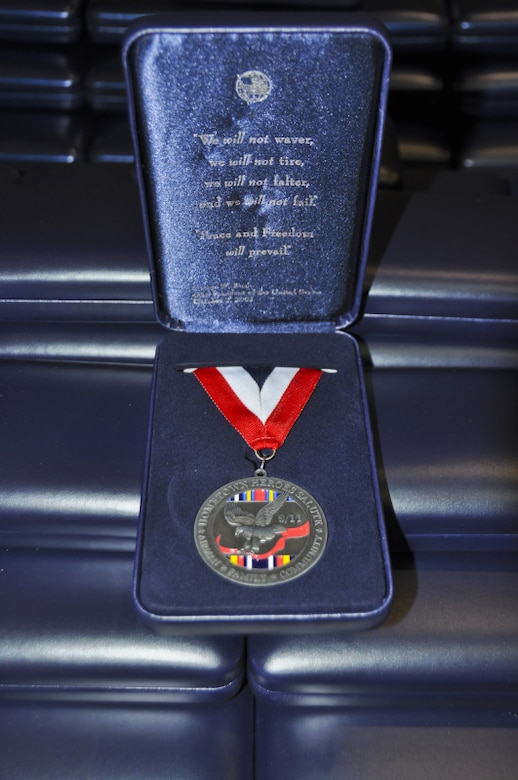 An award for center of influence medallion is set upon others of its kind during a Hometown Heroes Salute award ceremony at the 128th Air Refueling Wing, Milwaukee, on Sunday, December 4, 2011.  The award for center of influence medallion is given to Airmen who have deployed overseas for more than 30 days, and it is meant as a gift of respect to friends, family members, or other associates who helped an Airman during his or her deployment.  The Hometown Heroes Salute Campaign is an Air National Guard recognition event that started in 2009.  Air National Guard photo by Staff. Sgt. Jeremy Wilson.