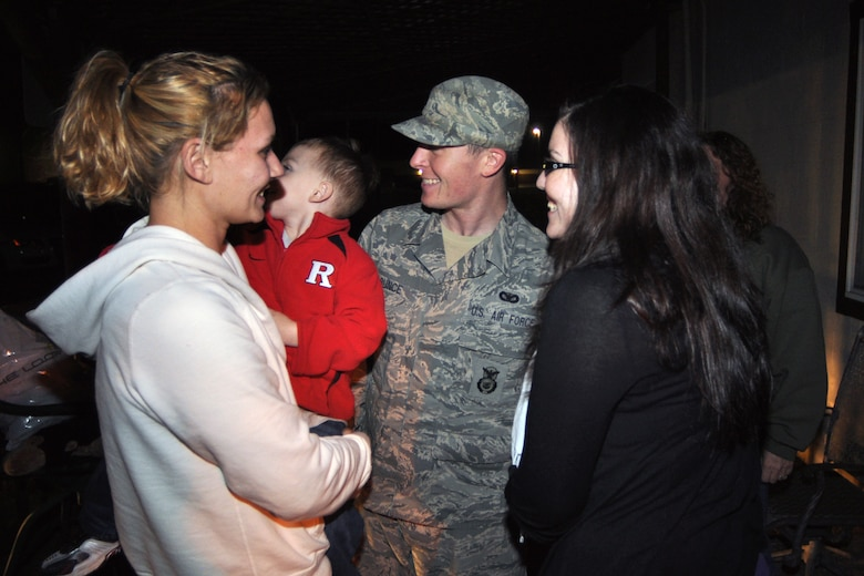 Staff Sgt. Donald Bunce, center, is all smiles as he is reunited with his sister, Ashley Laramai, and his wife, Mary, right, on Dec. 2, at Joint Base McGuire-Dix-Lakehurst, N.J., from a recent deployment to Iraq. Bunce was one of eight Airmen from the 108th Security Forces Squadron returning home from the approximately six-month deployment. (U.S. Air Force photo by Staff Sgt. Armando Vasquez, 108th WG/PA)