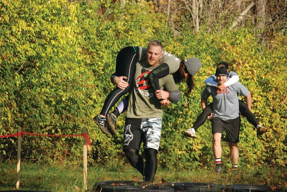 WRIGHT-PATTERSON AIR FORCE BASE, Ohio - Staff Sgt. Doug Young, Jr., 445th Airlift Wing command post, carries his partner through the woods during the Back to the Ranch CrossFit competition Oct. 22. (Courtesy photo)