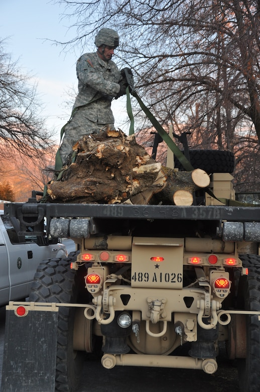 CENTERVILLE, Utah - A member of the Utah National Guard helps with clean-up efforts from a wind storm in Davis County, Utah on Dec. 4, 2011.  Utah Governor Gary Herbert activated approximately 200 members of the Guard to assist local authorities with the clean-up, and to prepare for an upcoming storm.  More than 25 heavy equipment vehicles were also dispatched to assist with the efforts. U.S. Army photo by 1LT Ryan Sutherland (RELEASED).