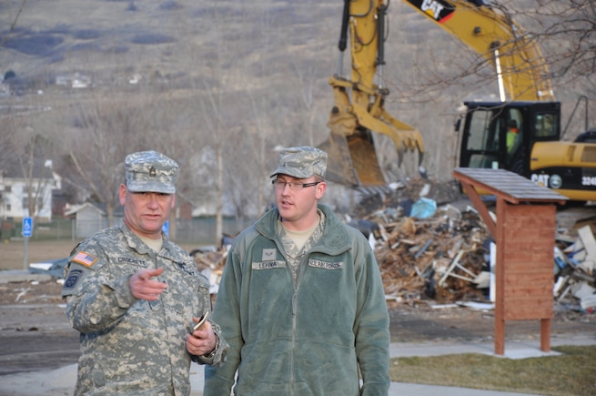 CENTERVILLE, Utah - Members of the Utah Army and Air National Guard assist with clean-up efforts from a wind storm in Davis County, Utah on Dec. 4, 2011.  Utah Governor Gary Herbert activated approximately 200 members of the Guard to assist local authorities with emergency response clean-up, and to prepare for an upcoming storm.  More than 25 heavy equipment vehicles were also dispatched to assist with the efforts. U.S. Army photo by 1LT Ryan Sutherland (RELEASED).