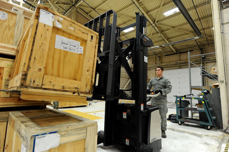 Senior Airman Chris Robinson, 28th Logistics Readiness Squadron aircraft parts technician, stacks crates of aircraft parts on a pallet at Dock 63 on Ellsworth Air Force Base, S.D., Nov. 3, 2011. Airmen across the Air Force will be tasked with looking for opportunities to conduct their jobs more efficiently and effectively now and in the future. (U.S. Air Force photo by Airman 1st Class Zachary Hada/Released)