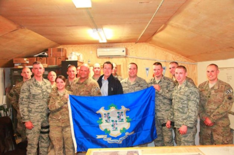 Connecticut Governor Dannel P. Malloy poses to take a photo with Airmen from East Granby, Connecticut of the 103rd Security Forces Squadron, Connecticut Air National Guard, stationed at Bagram Airfield during his visit to Afghanistan on November 16, 2011. (U.S. Army photo by Spc. Anthony Murray Jr/Released)