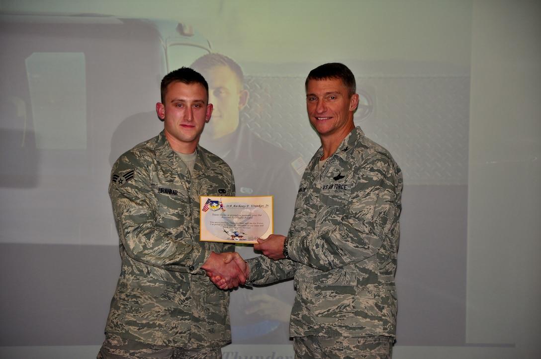 Senior Airman Anthony F. Urankar Jr., 51st Maintenance Squadron, recieves a an Airman Spotlight certificate from Col. Patrick McKenzie, 51st Fighter Wing commander, Dec. 6, 2011. (U.S. Air Force photo/Tech. Sgt. Chad Thompson)