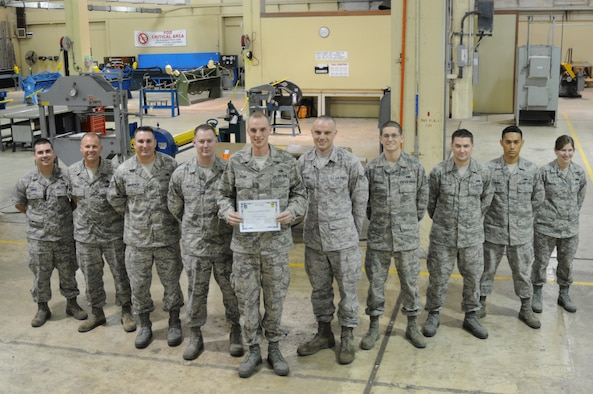 ANDERSEN AIR FORCE BASE, Guam- Senior Airman Jeremy Flint,36th Maintenance Squadron metals technology journeyman, was awarded Andersen's Best here, Dec.1. Andersen's Best is a recognition program which highlights a top performer from the 36th Wing. Each week, supervisors nominate a member of their team for outstanding performance and the wing commander presents the selected Airman/Civilian with an award. (U.S. Air Force photo/Senior Airman Carlin Leslie)