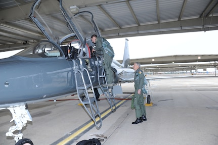 Capt. Landon Phillips, 12th Operations Group, performs a pre-flight inspection of a T-38C Talon from the 435th Fighter Training Squadron prior to take off Dec. 2.  Captain Phillips piloted the aircraft as a part of the dedication ceremonies for the Capt. Benjamin F. Danielson Auditorium in the 558th Flying Training Squadron. Retired Lt. Col. Jim George (right), the on-scene-commander for the majority of the Boxer 22 mission which attempted to rescue Captain Danielson, flew in the rear cockpit during the flight.  (U.S. Air Force photo/Rich McFadden)