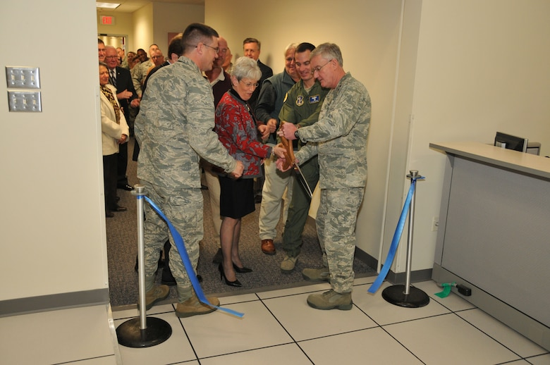 Col. Peter DePatie, 103rd Air Operations commander, watches as Connecticut Lieutenant Governor Nancy Wyman, 103rd Airlift Wing commander Col. Frank Detorie and Maj. Gen. Thaddeus Martin, The Adjutant General and commander of the Connecticut National Guard, cut the ribbon to the 103rd Air Operations Group's new facility at Bradley Air National Guard Base, East Granby, Conn., Dec. 3, 2011. (U.S. Air Force photo by Airman 1st Class Emmanuel Santiago)