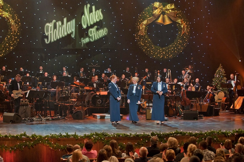 "The Band of the U.S. Air Force Reserve and Air Force Strings perform at the Grand Ole Opry House in Nashville, Tenn., during the taping of ""Holiday Notes from Home.""  The band joined Lee Ann Womack, and Little Big Town to record the hour-long special that will air on the American Forces Network and the Great American Country Network this holiday season. (U.S. Air Force photo/Ken Hackman)"