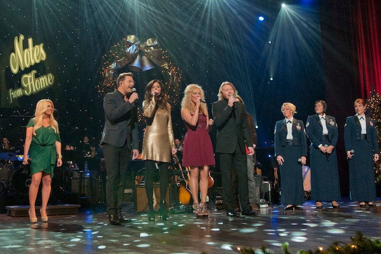 "Lee Ann Womack, Little Big Town and the vocalists from the Band of the U.S. Air Force Reserve perform the finale during the taping of ""Holiday Notes from Home"" at the Grand Ole Opry House in Nashville, Tenn. The hour-long special that will air on the American Forces Network and the Great American Country Network this holiday season. (U.S. Air Force photo/Ken Hackman)"