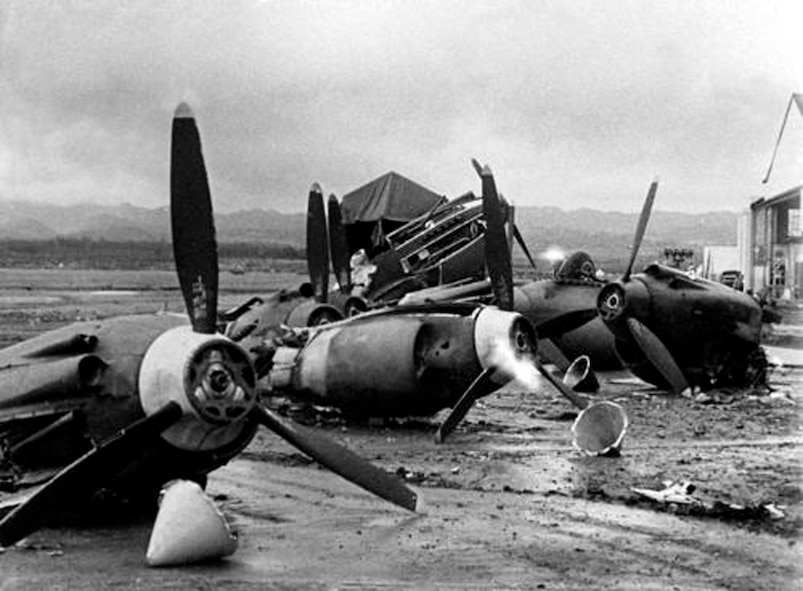 The wreckage of US Army Air Corps Aircraft at Hickam Field.  Of the 50 aircraft assigned to the 11th Bomb Group, 37 were damaged or destroyed in the attack.  Several of the suriving 11 BG aircraft participated in the search for the Japanese carrier force hours after the attack. (Courtesy Photo/Air Force Historical Research Agency)