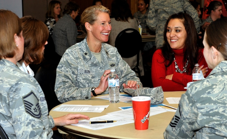 Brig. Gen. Dana Born and others introduce themselves during a roundtable session as part of the Air Force Academy's women's mentoring initiative Nov. 30, 2011. The purpose of the two-hour meeting was to present ideas on how a women's mentoring program could best meet the needs of the Academy's community. Born is the Academy's dean of the faculty. (U.S. Air Force photo/Elizabeth Andrews)