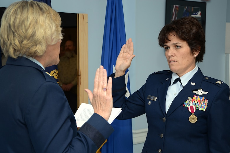 Col. Laurie Farris, Director of State Operations at State Headquarters, takes the oath of office from Brig. Gen. Carol Protzmann during her promotion ceremony Dec. 3 at Pease Air National Guard Base, N.H.  Col. Farris in her new position will be responisble for future missions for the N.H. Air National Guard.   (U. S. Air Force photo by Tech. Sgt. Mark Wyatt)