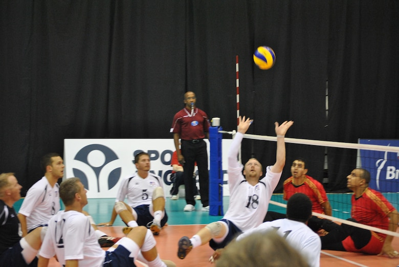 Tinker AFB employee J. Dee Marinko prepares to serve for the U.S. Men's Sitting Volley Team in a match against Azerbaijan during the Continental Cup in Kettering, England, earlier this year. The Americans placed eighth in the competition. (Courtesy photo by Kate Fit)