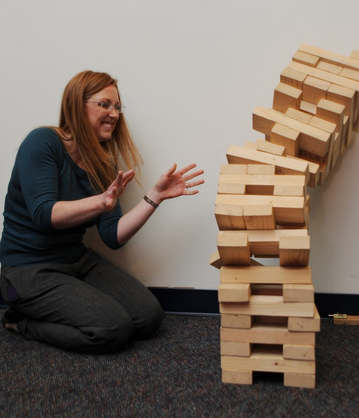 Erica Glon, Air Force District of Washington chief of community relations, fails at Jenga Dec. 8 at the USO pizza party on Joint Base Andrews, Md. The party had games and prizes for all servicemembers on JBA. (U.S. Air Force photo by Staff Sgt. Christopher Ruano)