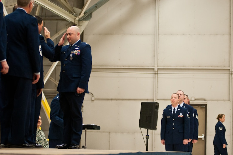 2nd Lt. Jeremy Funk, 139th Operations Group, salutes Col. Michael Pankau, 139th Airlift Wing commander, during an awards ceremony at Rosecrans Air National Guard Base Dec. 4, 2011. Funk and other Airmen were awarded the Air Force Achievement medal for outstanding service. (Missouri Air National Guard photo by Staff Sgt. Michael Crane)