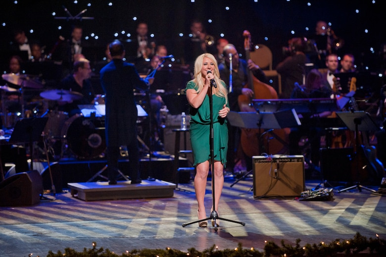 "Grammy winning vocalist Lee Ann Womack performs during the taping of ""Holiday Notes from Home"" at the Grand Ole Opry House, Nashville, Tenn. Womack joined Little Big Town, the Band of the U.S. Air Force Reserve and the Air Force Strings to record the hour-long special that will air on the American Forces Network and the Great American Country Network this holiday season. (U.S. Air Force photo/Ken Hackman)"