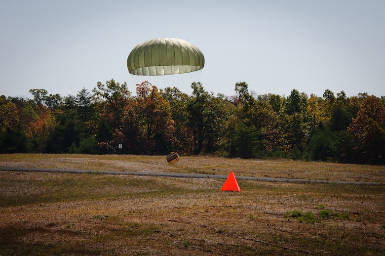 Cargo deployed from a Kentucky Air Guard C-130 Hercules lands within feet of its intended target during precision airdrops conducted Oct. 22, 2011, at Fort Knox, Ky., as part of the 165th Airlift Squadron's first-ever Air Derby. The contest scored crews in multiple areas, including threat and airspace avoidance, airdrop accuracy and assault landing accuracy. (U.S. Air Force photo by Senior Airman Maxwell Rechel)
