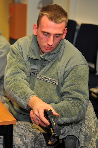 SPANGDAHLEM AIR BASE, Germany – Gabriel Kastner, 52nd Security Forces Squadron police officer, spark tests a Taser X26 during training inside Bldg. 127 here Dec. 8. Training for the Taser X26 electronic control device consists of a classroom comprehension course, hands-on field training and a supervised firing course. Students complete Taser training to ensure they are able to safely handle and operate all Taser equipment. (U.S. Air Force photo/Airman 1st Class Dillon Davis)