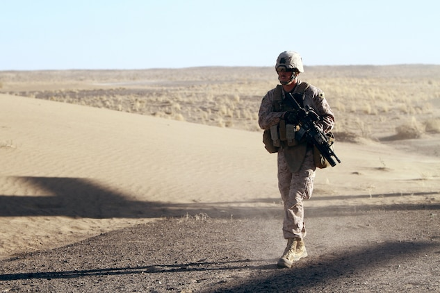 U.S. Marine Sgt. Ryan McDowell, a 24-year-old rifleman from Kent, Ohio, moves toward a target during an air interdiction force mission here, Dec. 7. The AIF mission was conducted in support of an Afghan Border Police led clearing operation in Khan-Neshin. During the mission, Marines and sailors from Charlie Co., 1/25, and 2nd Bn., 11th Marines, circled above, searching for suspicious vehicles or personnel. The AIF plays a unique role with Regimental Combat Team 5's counter-insurgency operations in southern Helmand.