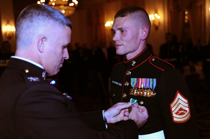 Gunnery Sgt. Jonathan Bley, small ensemble leader with the Marine Corps Recruiting Depot San Diego Band, receives a Navy and Marine Corps Commendation Medal after receiving the Staff Noncommissioned Officer Marine Musician of the Year award, Dec. 13. The awards banquet was held at the Hilton Chicago.