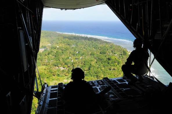 ANDERSEN AIR FORCE BASE, Guam - The view out the back of a C-130 Hercules during Operation Christmas Drop, Dec. 12.  The island of Fais is located within the Yap state of the Micronesian Islands and is one of the more than 50 islands that will receive care packages this holiday season as part of OCD. (U.S. Air Force photo/Senior Airman Carlin Leslie)