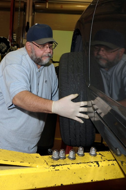VANDENBERG AIR FORCE BASE, Calif. -- Eric Whittaker, a United Paradine contractor, changes a tire at the auto hobby shop here Friday, Dec. 9, 2011. The auto hobby shop is open to customers with base access offering a variety of services and a knowledgeable staff to help with automotive projects. (U.S. Air Force photo/Jerry E. Clemens Jr.)