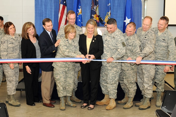 "Congresswoman Ann Marie Buerkle presents the 174th Fighter Wing Commander, Col. Kevin Bradley, Lt. Col. Maryjo Timpano, and Army Lt. Col. Conte with a letter certifying the opening of the Hancock Field Joint Heath and Wellness Center facility.  The newly opened J-HAWC is a ""one stop shop"" for all Hancock Field members and family. The J-HAWC provides many services in one central location, ranging from mental well-being to financial services to fitness programs and family services. The ribbon cutting ceremony of the new Hancock Field, J-HAWC facility took place on 4 December 2011. (U. S. Air Force photo by: Staff Sgt. James N. Faso II/RELEASED)"